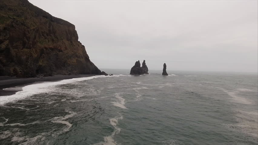 Panning Right Over The Sea Viewing 4 Protruding Rocks At V\xCC_k Iceland
