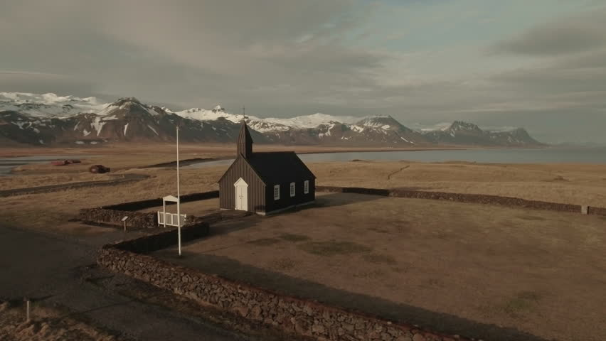 Drone Footage Of Old Church And Snowcapped Mountains At Budir