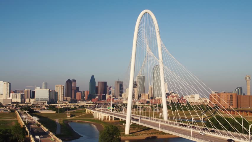 Ariel shots of the Margaret Hunt Hill Bridge with the Dallas Skyline in the Background