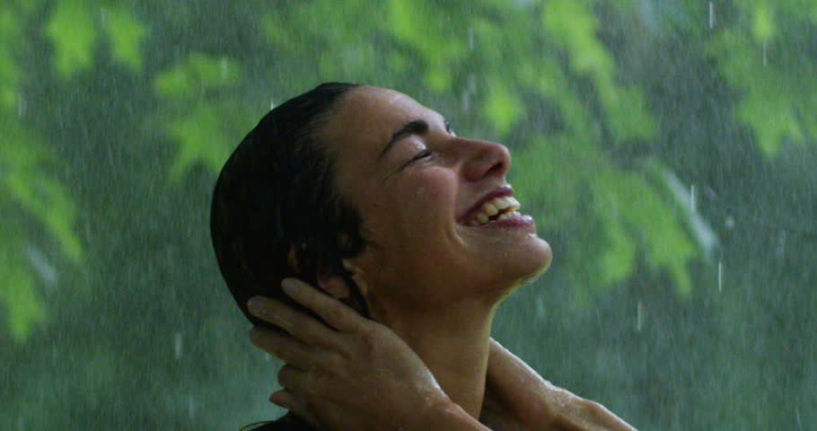 On a hot summer day a woman smiling under water surrounded by greenery. It refreshes under water and feel that your body gets the benefit of the water fresh.