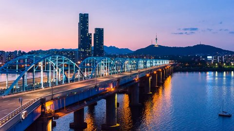 Time lapse of Seoul City skyline at Dongjak Bridge and Han river in Seoul, South Korea.