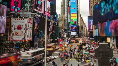 New York, USA - July 5, 2016: Time lapse view of people and traffic at Times Square, famously adorned with billboards and advertisements, in Manhattan, New York City, United States of America.