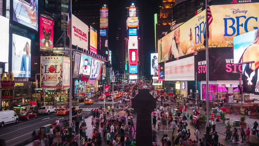 New York, USA - July 5, 2016: Time lapse view of Times Square at night, famously adorned with flashy billboards and advertisements, in Manhattan, New York City, United States.