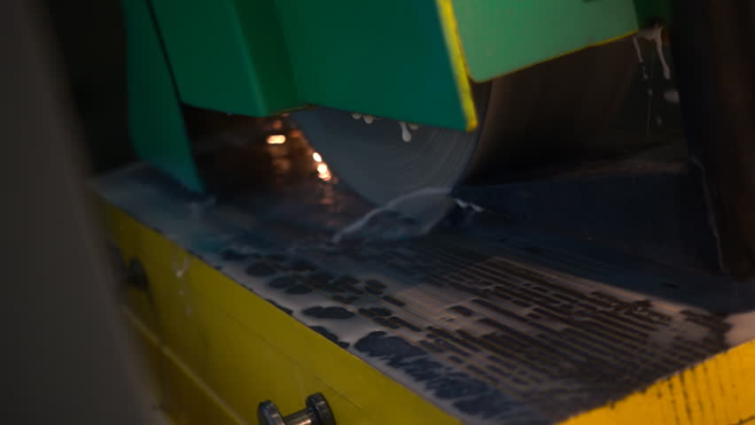 Grinder machine processes the metal workpiece. Flying sparks. Slow motion, high speed camera, 250fps | Shutterstock HD Video #17973133