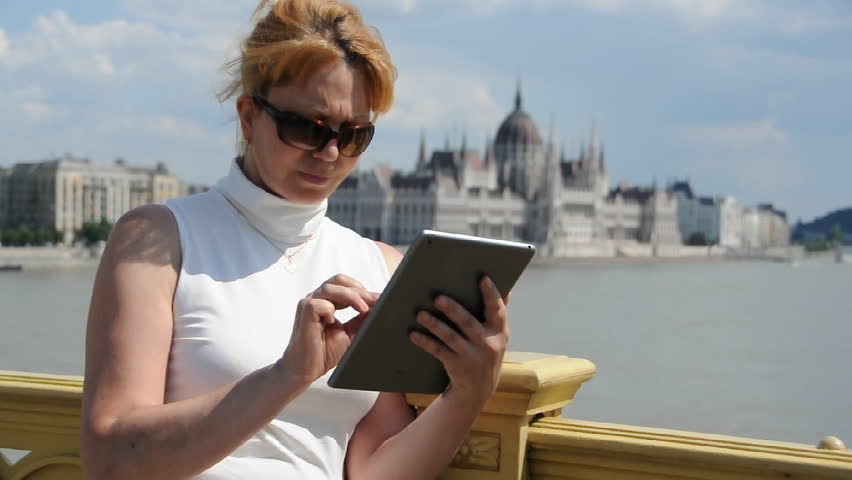 woman typing on  a plate on bakground Budapest