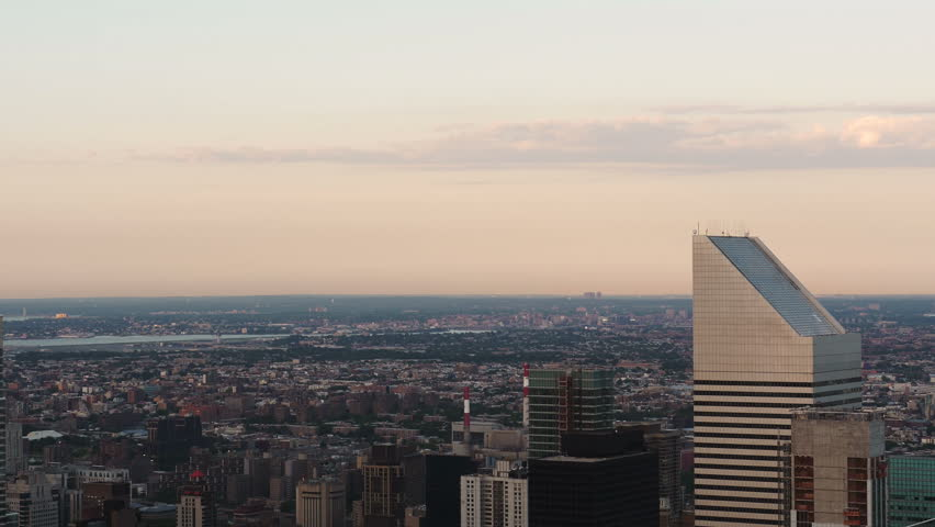Midtown Manhattan Buildings at Dusk with La Guardia Airport seen in the background  4k | Shutterstock HD Video #18004483