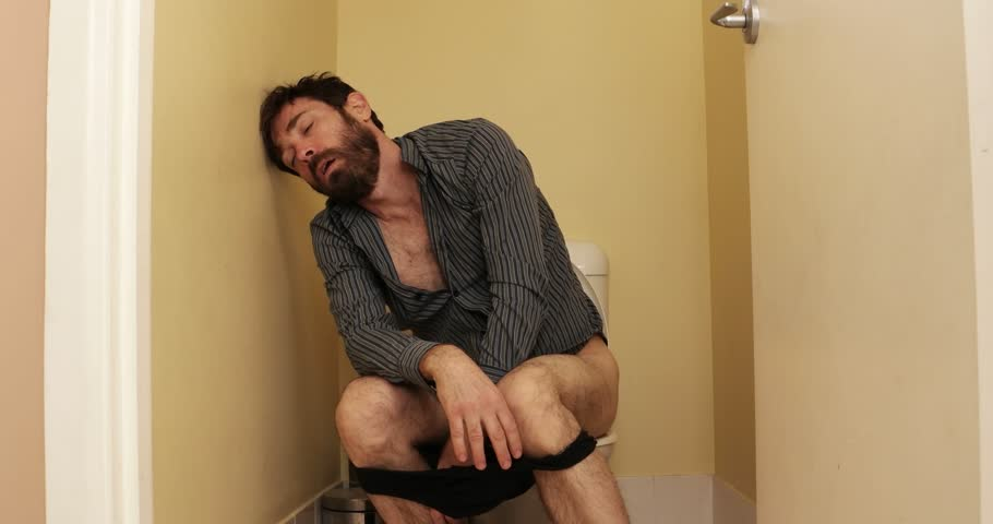drunk man in toilet asleep