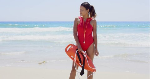 Side view on woman in red with buoy