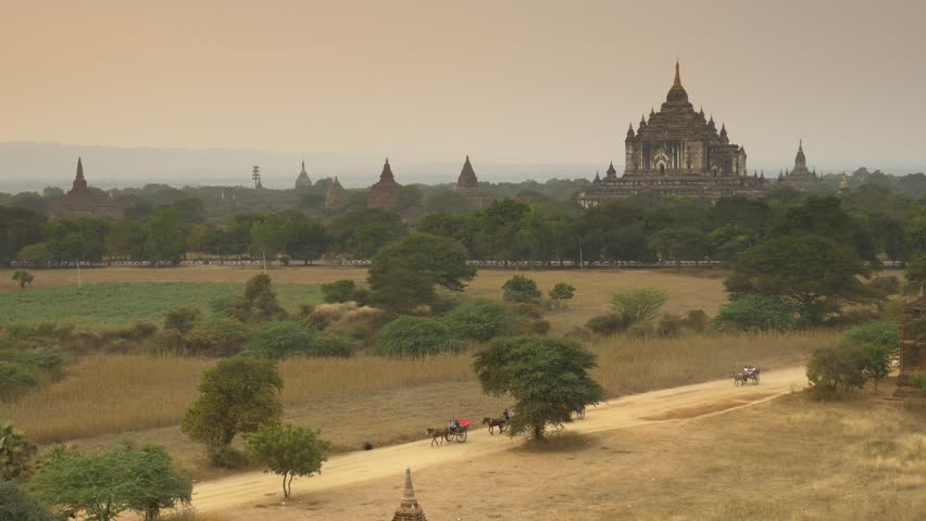 Horse carts in the plain of Bagan at sunset, Bagan, Myanmar  | Shutterstock HD Video #18046003