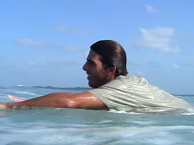 Surfer swimming