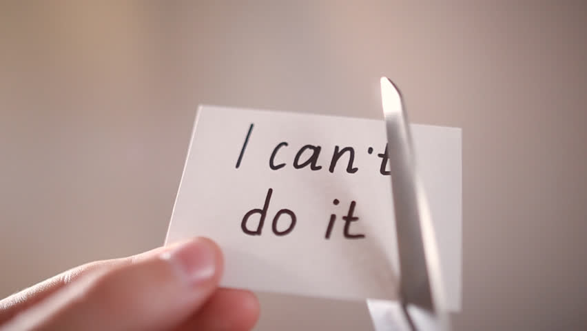 Man using scissors to remove the word can't to read I can do it concept for self belief, positive attitude and motivation | Shutterstock HD Video #18083563