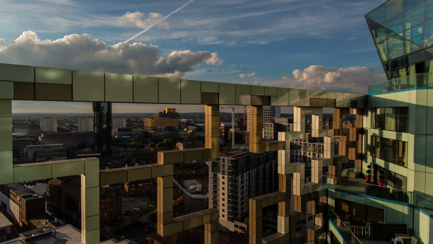 Birmingham sunset time lapse from the Cube. Closer shot of the structure of the iconic Cube structure as a dramatic sunset occurs.