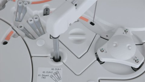 Robotic armworks with medical analysis, test in pharmaceutical factory.
