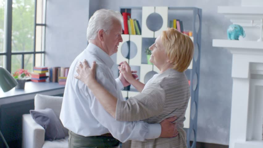 Active retirement and leisure activities, happy dance of an elderly couple