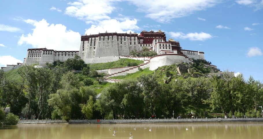 4k timelapse clouds rolling Potala in Lhasa,Tibet.lake with willow in lasa park. gh2_08936_4k