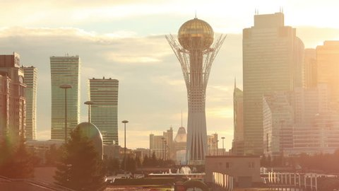 ASTANA, KAZAKHSTAN - JULY 06, 2016: picturesque view of Bayterek tower at sunset in downtown of Astana city, capital of Kazakhstan on July 06, 2016. Time Lapse.