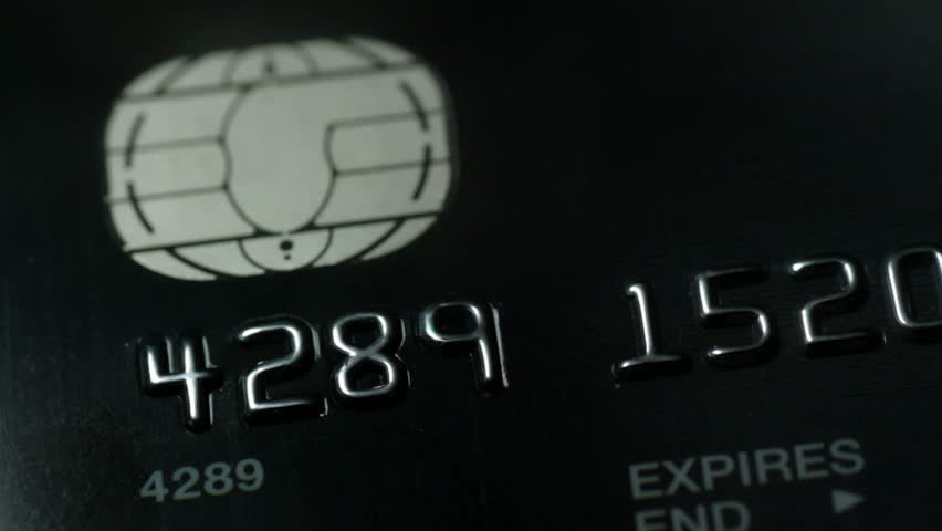 scanning credit card with green laser, finance concept