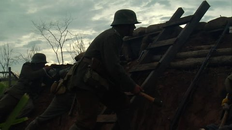 PENNSYLVANIA - APRIL 2014 - large-scale, epic Re-enactment, recreation, WW1 The Great War in the middle of battle. German Soldiers rifle and machine gun in combat. muzzle flashes, gunfire in trenches.
