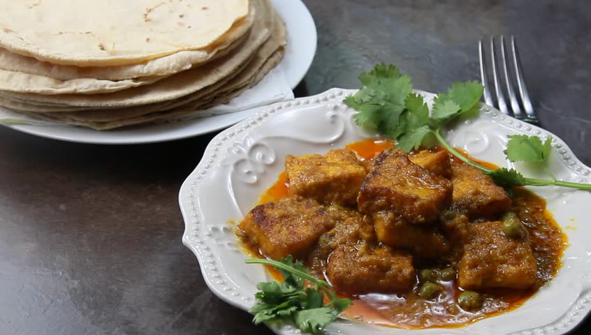 Plated Paneer butter masala with chapati or roti on the side