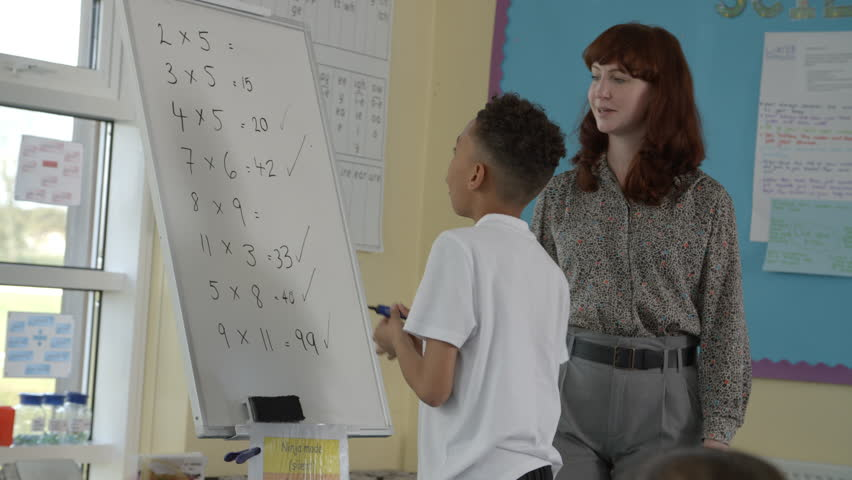 Pupil Writes Answer To Maths Problem On Board Shot On R3D   Shutterstock HD Video #18294907