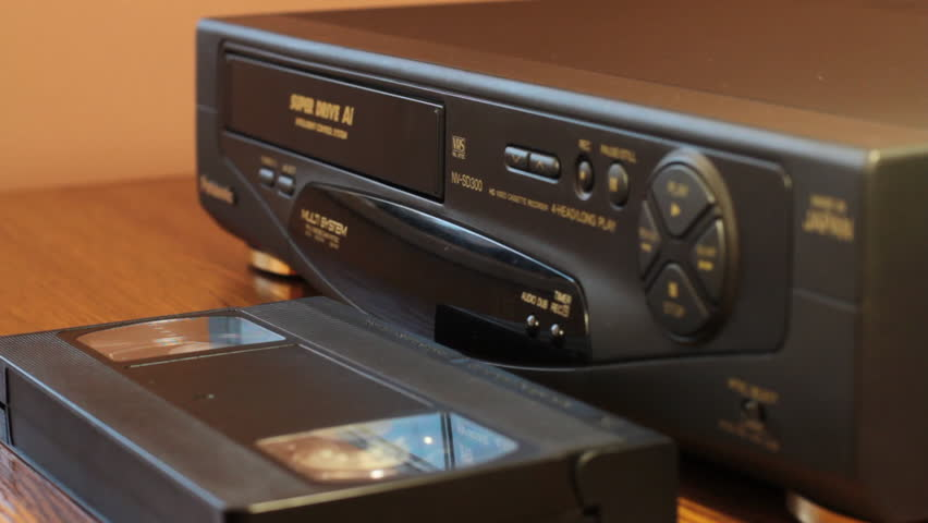The Girl Inserts A Cassette Into VCR
