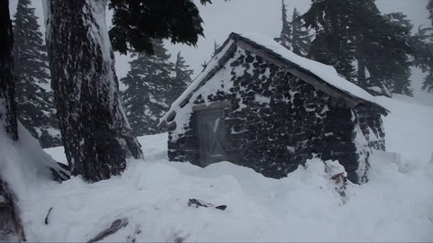 Snow covered cottage in a blizzard in the North Cascades