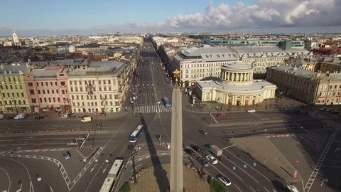 Beautiful aerial quadcopter view Vosstaniya Square in St.Petersburg Russia, Nevsky avenue with cars. Morning light. Old rooftops.