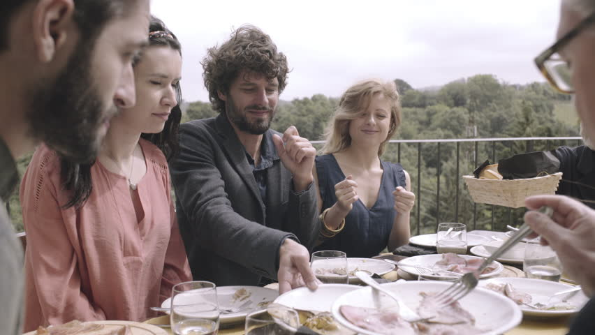 Family dining outdoors on holiday in Italy | Shutterstock HD Video #18420703