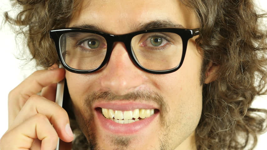 Young Man in Glasses Talking on Phone, Close Up | Shutterstock HD Video #18422323