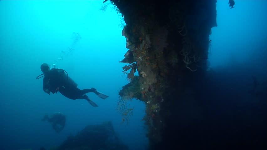 Female model scuba diver swimming on wreckage in Solomon Islands, HD, UP27998 | Shutterstock HD Video #18422863
