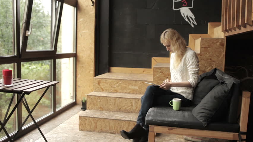 Girl With Tablet Sitting in Cafe | Shutterstock HD Video #18459133