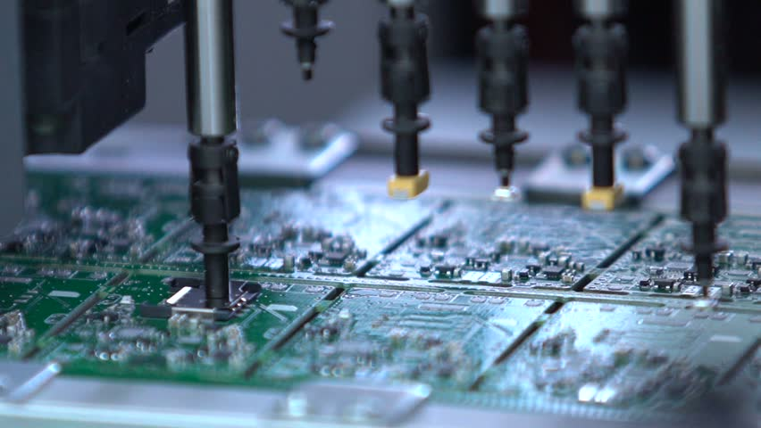 Electronic circuit board production. Automated Circut Board machine Produces Printed digital electronic board. Electronics contract manufacturing. Manufacture of electronic chips. High-tech | Shutterstock HD Video #18465187