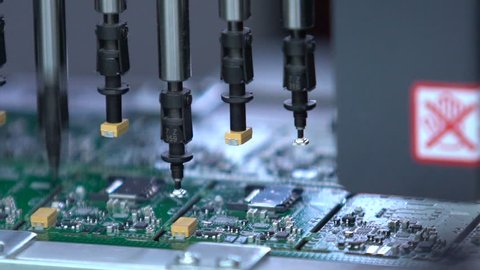 Electronic circuit board production. Automated Circut Board machine Produces Printed digital electronic board. Robotic production of printed Circut Board. Producing Printed Circut Board.