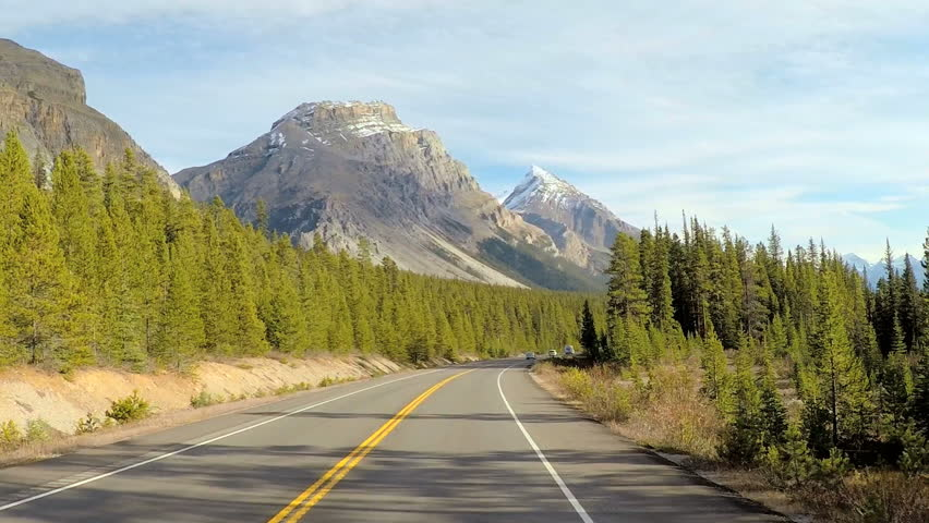 POV road trip driving through the scenic beauty of Icefields Parkway in Canada