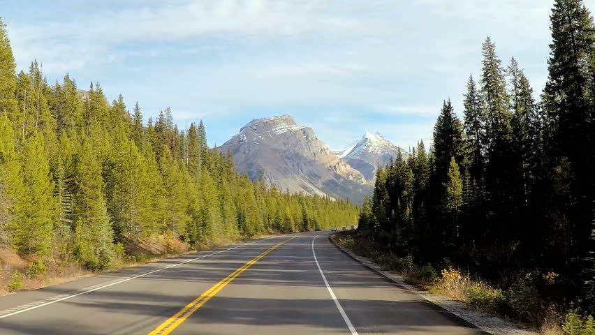 POV road trip driving through Icefields Parkway in Canada