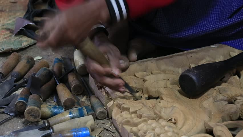 Burmese man are making wooden souvenirs for tourists in Bagan, Myanmar. Wood Carving is a traditional handicraft in Myanmar, Burma