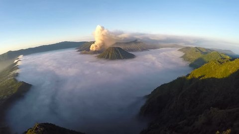 Aerial view flight over Mount Bromo volcano during sunrise, the magnificent view of Mt. Bromo located in Bromo Tengger Semeru National Park, East Java, Indonesia.