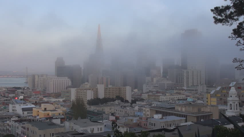 Famous San Francisco panorama in foggy day, modern construction with Pyramid building