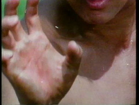 Close-up of barechested man's hand shaking