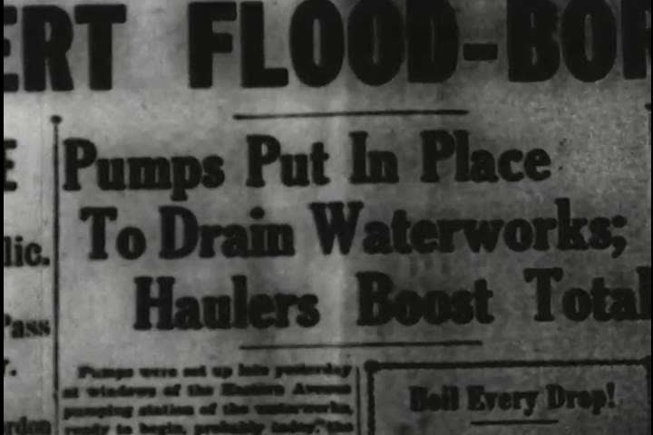 Pumps used to drain water on Eastern Avenue in flooded Louisville, Kentucky in the 1930s. (1930s) | Shutterstock HD Video #18558623