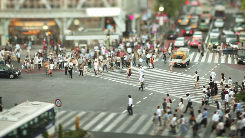 Thousands of people walk across the famous Shibuya Crossing in Tokyo Japan #18564275