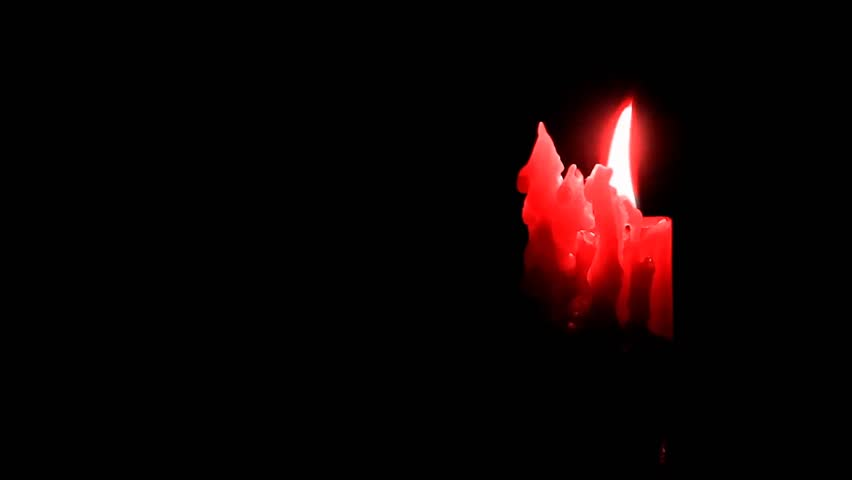 Candlelight Color Against Black Background   HD Stock Video Clip