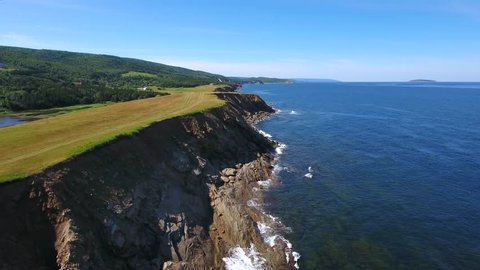 An amazing aerial landscape shot of the rugged shore on Cape Breton Island Nova Scotia Canada