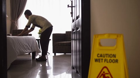 Asian maid working and cleaning in luxury hotel room. Young people at work, woman, girl, jobs, profession. Dolly shot