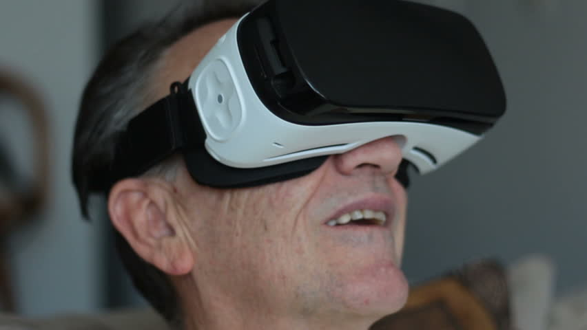 Senior Man Experiencing Virtual Reality - 360 Movie VR Video 3D - New Immersive Technology - Smooth Slider Dolly Shot    Shutterstock HD Video #18630743