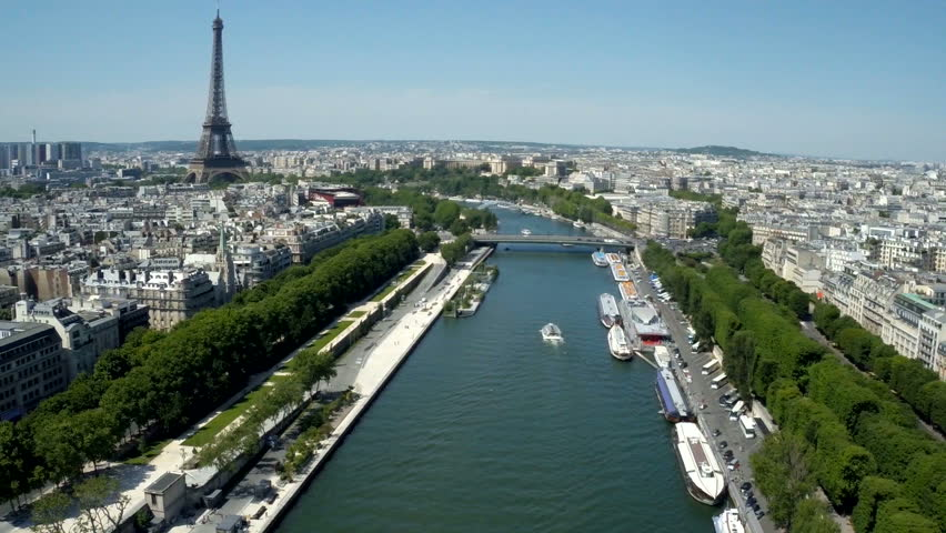 Aerial view of Paris, France with Seine River and Eiffel tower in background.   Shutterstock HD Video #18667343