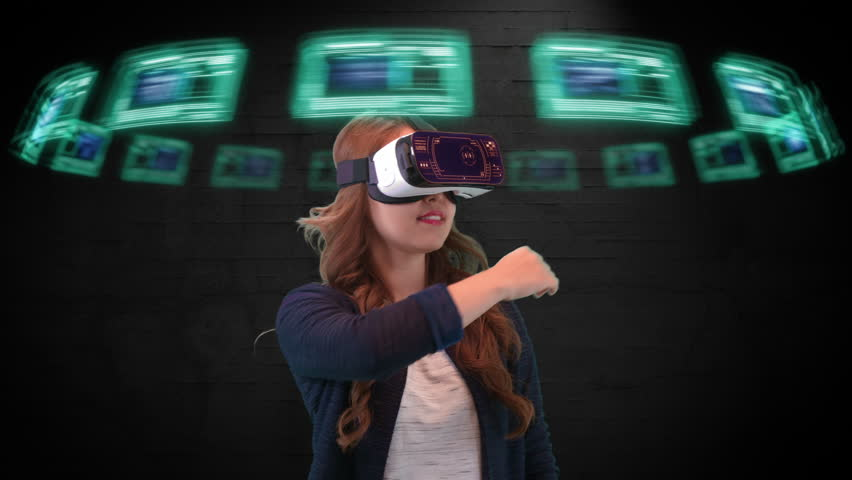 Young Asian female wearing virtual reality goggles uses futuristic holographic interface to access digital data