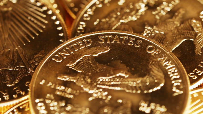 4K macro video with close up of the words United States of America on a rotating gold eagle US mint coin representing safe investment or return to gold standard