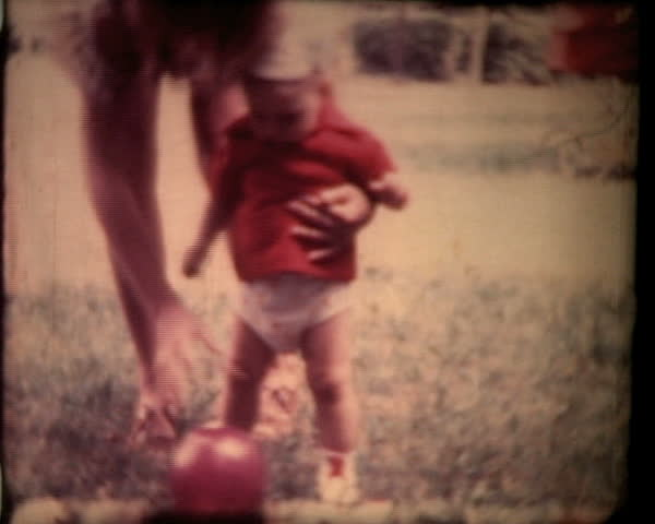 Boy plays with ball, vintage 8mm footage. 1 min version.