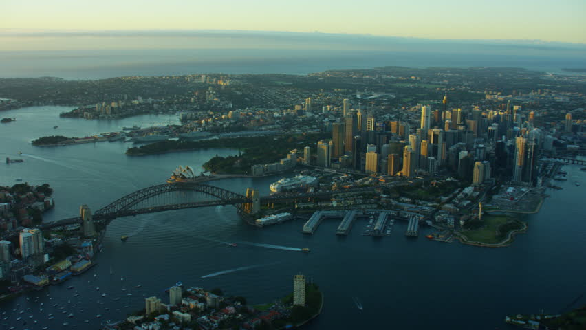 Aerial view at sunrise of Sydney Harbour Bridge and downtown city buildings | Shutterstock HD Video #18708980